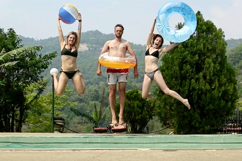 Guests Having Fun by the Pool in Pokhara